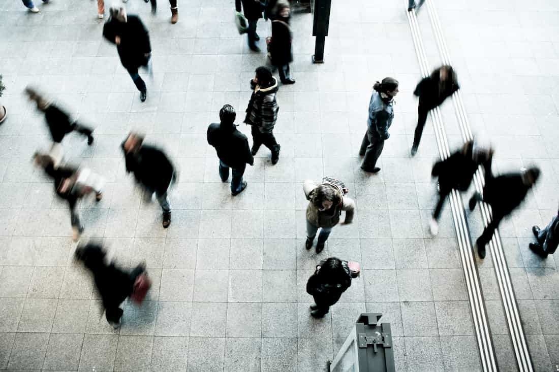 A crowd of people walking in different directions