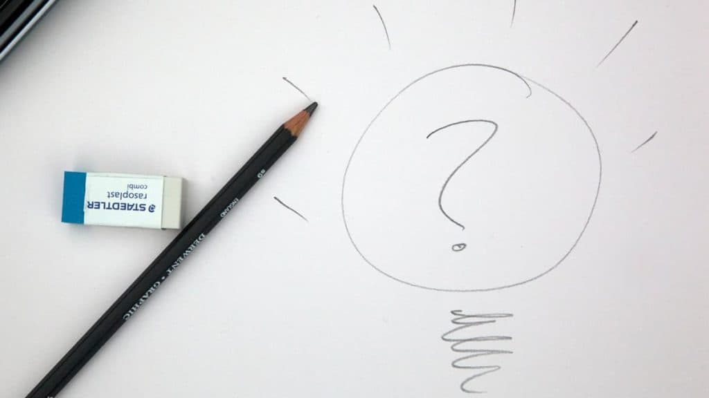 Pencil and eraser with a hand drawn lightbulb and question mark