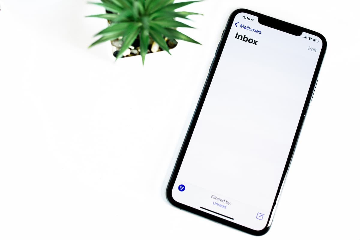 Phone Open on Inbox With White Background